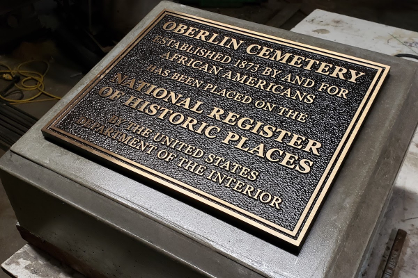 National plaque at fabricator